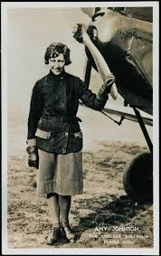 Amy Johnson standing by the front of her aeroplane after flying from England to Australia
