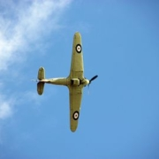A hawker hurricaneWW2 fighter plane flying in a blue sky