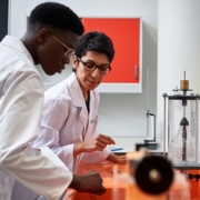 Maryam Imani instructing a student in the lab