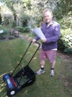 Julian Stocker cutting the grass and practicing his music